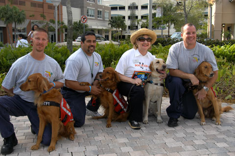 President and CEO Virginia Jacko with Miami-Dade Fire Rescue Search and Rescue Canine Team- Florida Task Force 1