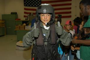 "Miami Lighthouse summer camp student gives the ""all is a go"" dressed in Coast Guard gear."