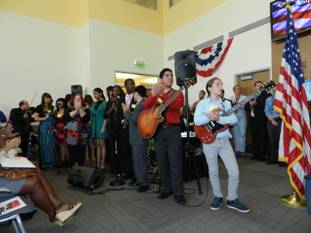 Miami Lighthouse performers congratulate the new citizens