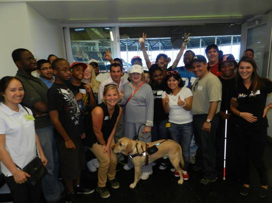 Miami Marlins President, David Samson and CEO of Miami Lighthouse Virginia Jacko celebrate the Marlins victory with summer program students and staff.