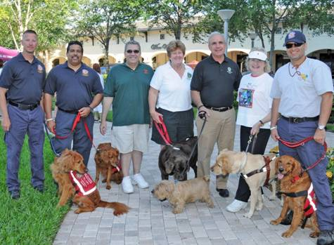 Miami-Dade County Public Defender Carlos Martinez, County Commissioner Sally Heyman, Miami-Dade County Mayor Carlos Gimenez, President and CEO of Miami Lighthouse for the Blind Virginia Jacko with Miami-Dade Fire Rescue Urban Search and Rescue Team.