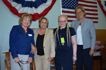 CEO Virginia Jacko, Congresswoman Ileana Ros-Lehtinen, District Director of the USCIS Miami Field Office Linda Swacina and Better Chance Music Production Program™ student Angel Wallace who sang the National Anthem.
