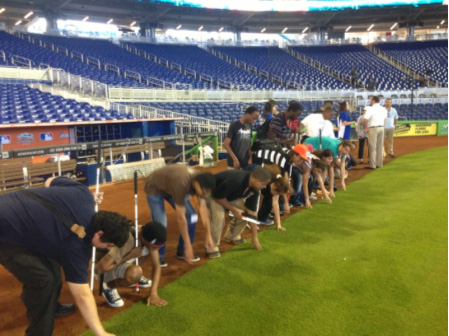 Transition students get the opportunity to feel the infield grass at Marlins Ballpark