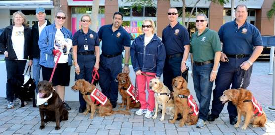 Janice Bartleson, David Bannister, Margot Mankes Aide to County Commissioner Sally Heyman, CEO Virginia Jacko, Miami-Dade County Public Defender Carlos Martinez, with Miami-Dade Fire Rescue Urban Search and Rescue Team.