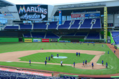 Miami Lighthouse summer camp students and Marlins interns on the baseball diamond