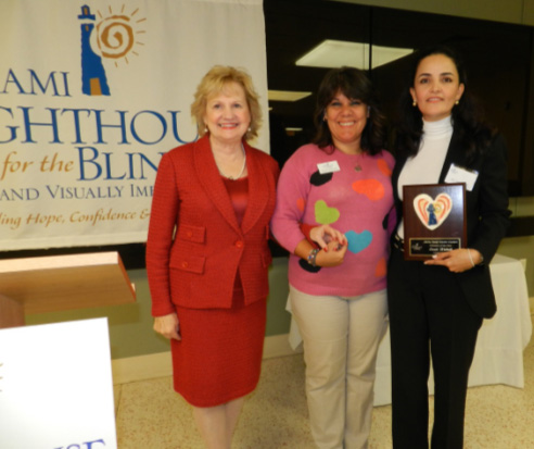 President & CEO Virginia Jacko, Coordinator of Arts & Crafts Nelbra Gonzalez and Honoree Susie Wahab.