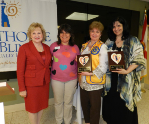 President & CEO Virginia Jacko, Coordinator of Arts & Crafts Nelbra Gonzalez, Honoree Lion Dilma Rodrigues and Honoree Edith La Riva.