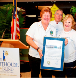 Miami-Dade County Commissioner Sally Heyman presents proclamation to Board Chair Ramon Casas and CEO Virginia Jacko.