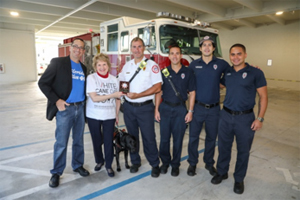 Doug Bartel of Florida Blue and CEO Virginia Jacko with City of Miami Department of Fire Rescue
