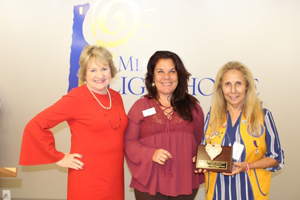 CEO Virginia Jacko, Nelba Gonzalez and Honoree Lion Maria Augusta Pusey.