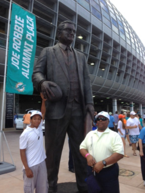 Miami Lighthouse program participants with Joe Robbie statue