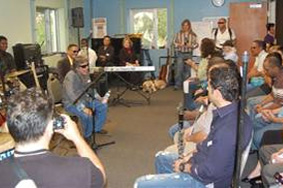 Jose Feliciano speaks to the workshop group.