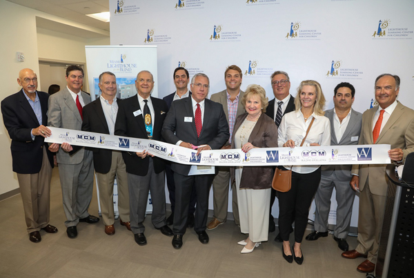2017 Board of Directors at the Lighthouse Learning Center for Children™ Building Dedication Ribbon Cutting Ceremony with Dr. Eduardo Alfonso, Chairman of Bascom Palmer Eye Institute.