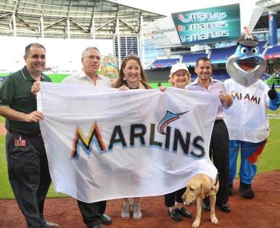 Alfredo Mesa Executive Director of Miami Marlins Community Foundation, Honorary Board Director Ray Casas, Joanne Messing Director of Foundation Partnerships, President & CEO Virginia Jacko, David Samson Miami Marlins President and Billy the Marlin.