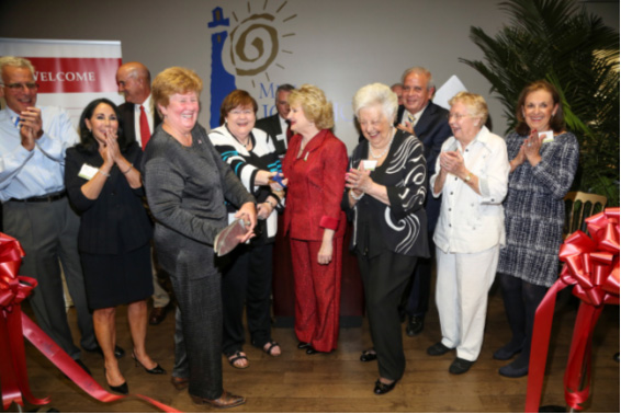 Ribbon cutting celebration: Jan and Daniel Lewis, Agustin Arellano, Sr., Commissioner Sally Heyman, Mrs. Sash A. Spencer, Chair-elect Ray Casas, Virginia Jacko President & CEO, Carmella Witt, Mayor Tomas Regalado, Marta Weeks Wulf and Penny Stamps.