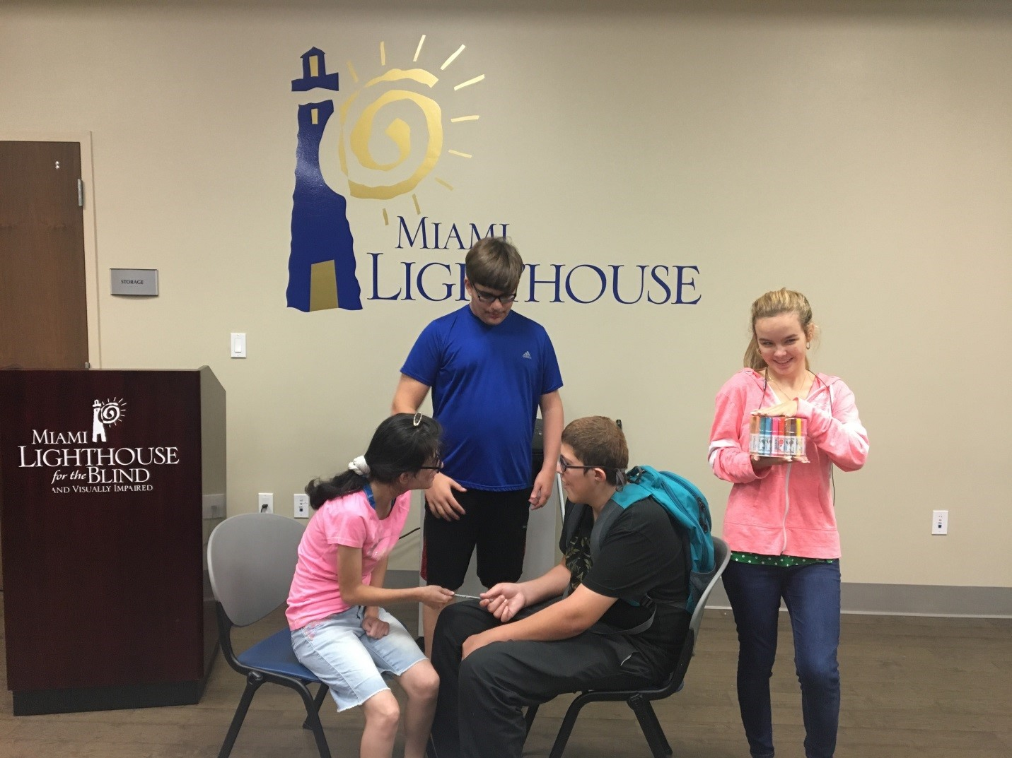 Four Pre-Employment Transition Services students engaged in a role playing activity