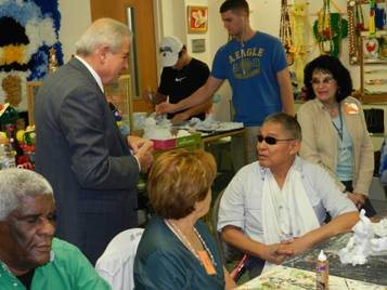 Mayor Regalado speaks with clients in Social Group Activities