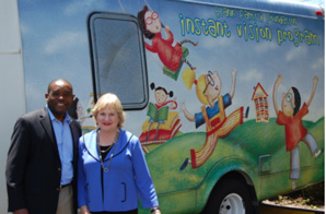 Virginia Jacko, CEO of Miami Lighthouse, gives a tour of the Heiken mobile eye care unit to Commissioner Monestime
